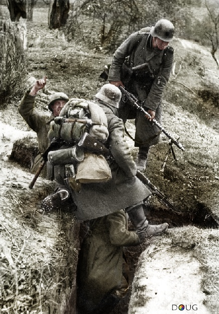 German soldiers examine a Russian trench during the advance towards Moscow, circa 1941.