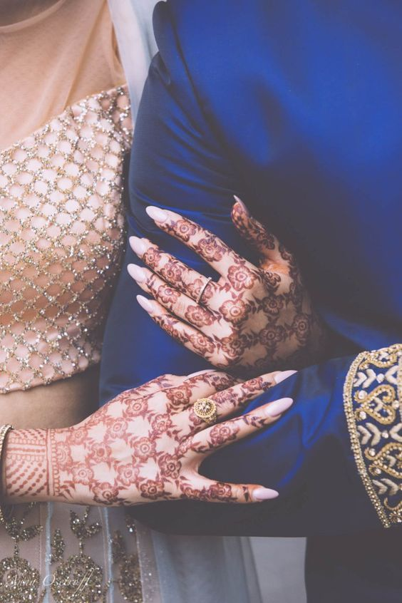 Henna bride hands intricate flowers with crosses