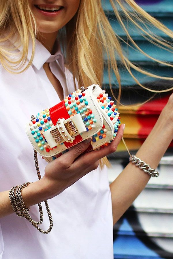 Mini Christian Louboutin clutch with multicolored spikes? Count us in.