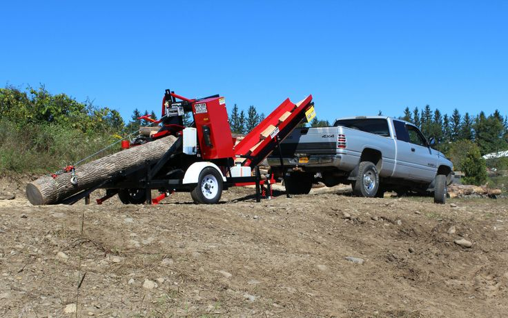 Badger Firewood Processor, made by Hud-Son USA. Robust 16hp v-Twin engine, hydraulic chainsaw mounted to chassis.