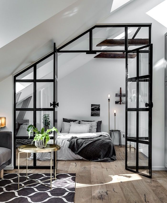industrial canopy to separate a bedroom from the living room, wooden floor