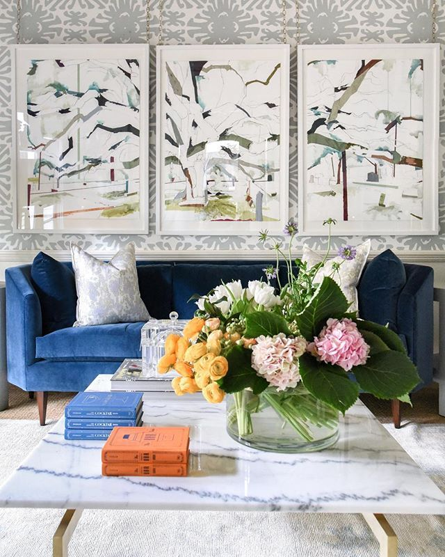 living room design with bold navy velvet sofa | art by jill lear | witness trees | quadrille fabrics wall coverings | blue print | blueprintstore.com