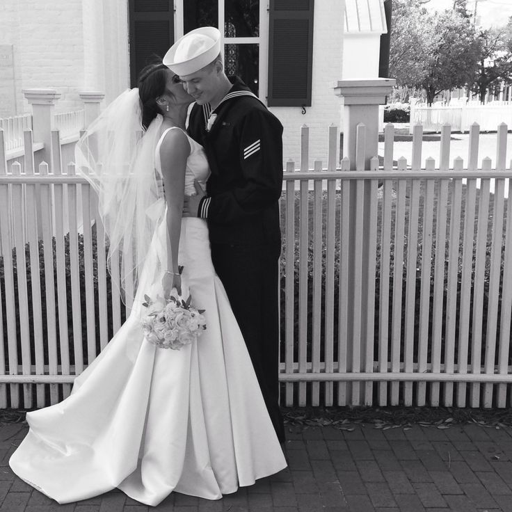 Wedding love US navy sailor dress happy couple poses