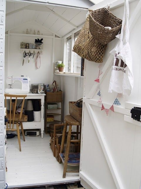 "a sewing shed. Love white mixed with ""old wood"" and wicker baskets!"