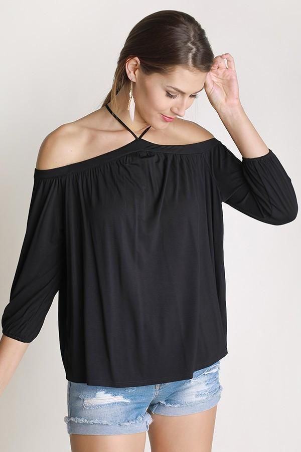 The Sing It Now SpaghettiStrap Off The Shoulder Top - Blackis the perfect top to put on your favorite song and lose yourself in the music! This soft top isa stunning blackthat falls from spaghetti straps to an off the shoulder neckline, 3/4 sleeves and relaxed bodice. This top is made with Bamboo fabric so it is very soft!