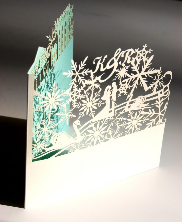 Winter wonderland laser cut wedding invitations in sea foam blue & ivory - obviously not with a winter wonderland theme, but maybe with a tropical theme?