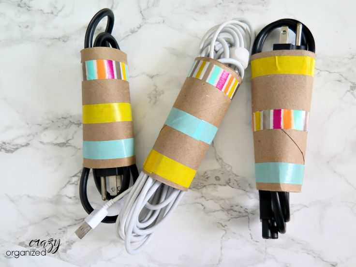 Surprising way to use toilet paper rolls to organize cords! Add a little washi tape for a bunch of color to this easy organizing trick!