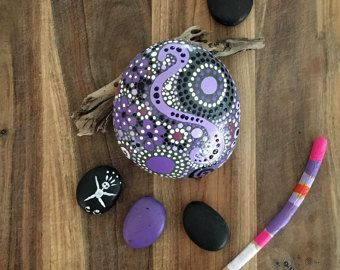 FREE SHIPPING!  Hand Painted River Rock - purple gloaming collection Trio #31 (2) stones 3.5 X 3.5 1 (1) 3.5 X 3 X 1- total weight - 37 ounces  Mandala Inspired Design - Natural Home Decor - Garden Decoration - Weather Resistant Lacquer  Color is the key to shopping at ethereal & earth. The stone collections are inspired by the colors & moments of nature. The purple gloaming collection takes its cue from the colors revealed at dusk. The calming purple shades and the calming texture and…