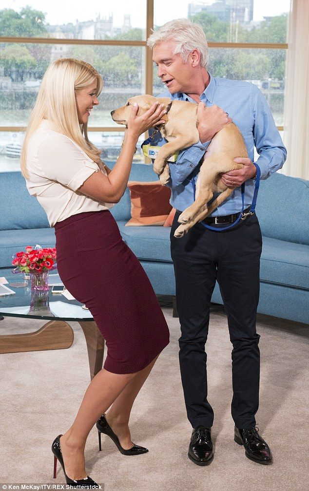 Happy families: Holly and Phil welcomed their new puppy to the This Morning family on Tuesday