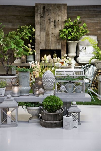Beautiful accessories that could work indoors or outdoors...love the urns, lanterns & terrarium