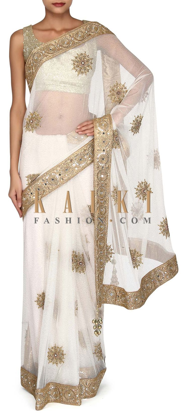Buy Online from the link below. We ship worldwide (Free Shipping over US$100). Product SKU - 302925. Product Link - http://www.kalkifashion.com/white-saree-adorn-in-embroidered-border-only-on-kalki.html