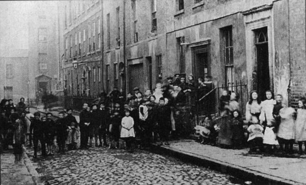 Inhabitants of just one of the many overcrowded slum tenements that dotted inner city Dublin c.1913.