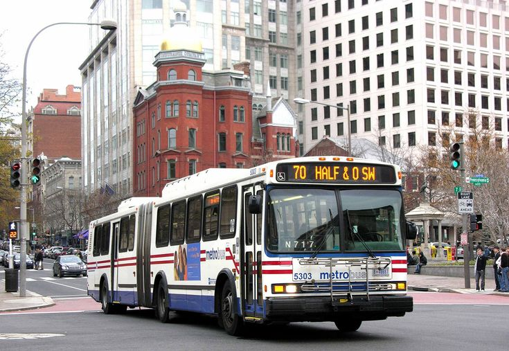 https://flic.kr/p/7NUdy5 | Washington DC Metrobus 5303, a 2002 Neoplan N-460 ART--D southbound on 7th St at Pennsylvania Ave on Line 70 | Only a Washingtonian could understand that destination display! It now no longer exists as a possible destination anyway, as it would be the geometric center of the Nationals' Baseball Park!