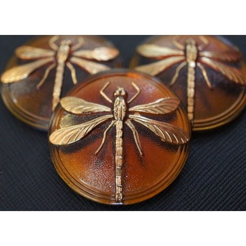 http://www.scarabeads.com/Cabochon-Topaz-Gold-Dragonfly-size-18