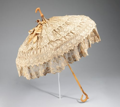 "omgthatdress:  Parasol ca. 1880-1890 via The Costume Institute of The Metropolitan Museum of Art ""Parasols were for show, carried as an accessory to complete a toilette. This example is fitted with a crook at top so it could be carried with the canopy down for a more elegant line than carrying it from the handle end. In addition, this shows off the tiers of feminine ruffles."""