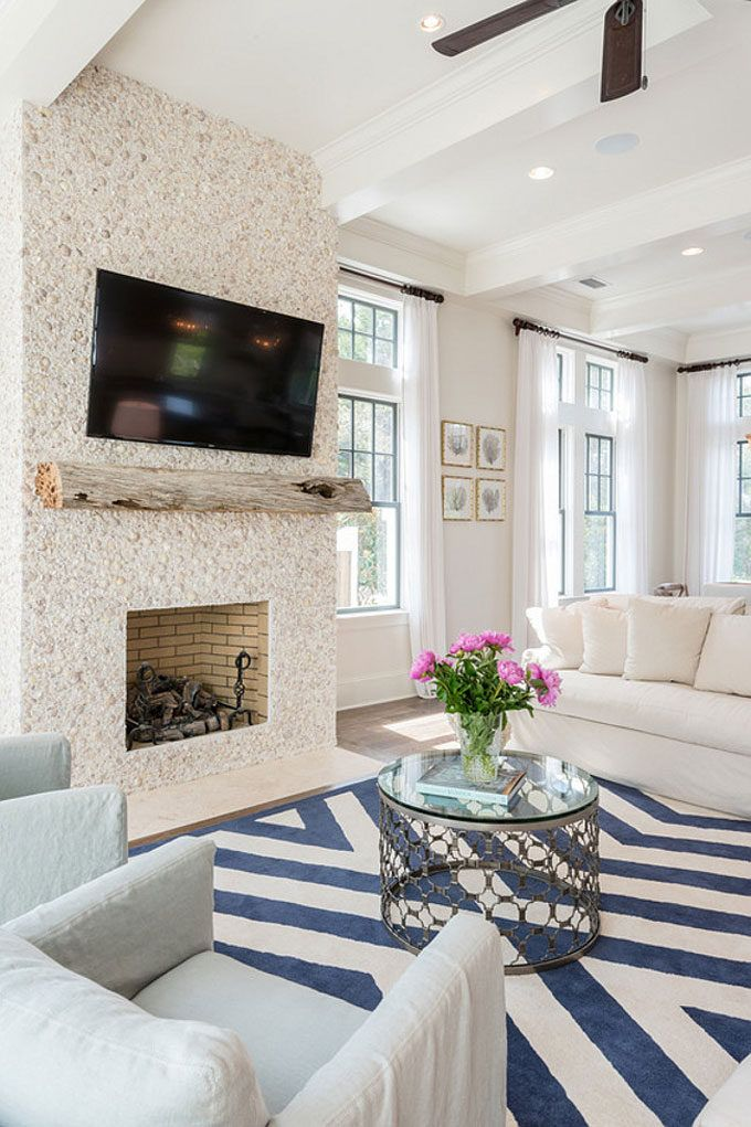 The Dreamiest Coastal Home in Seagrove Beach - Tabby Shell Stucco Fireplace in the Living Room