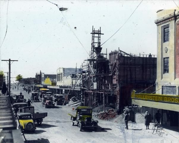 Dalton Street, Napier The photograph shows rebuilding of shops and businesses in Dalton Street, Napier. The previous buildings were destroyed in the 3 February 1931 earthquake. Hallenstein Brothers shop is shown on the right. Photographer, unknown. Date unknown.