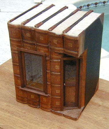 I love the idea of taking an old book and turning it into an indoor fairy house!