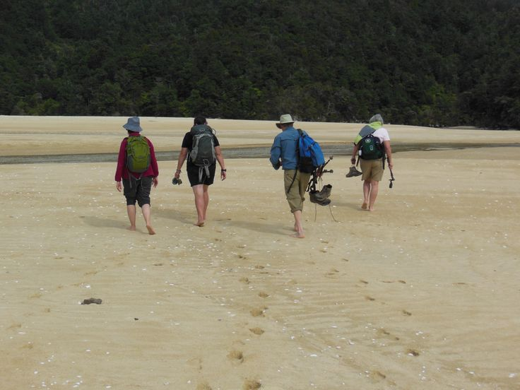 Walking the beach in Abel Tasman.
