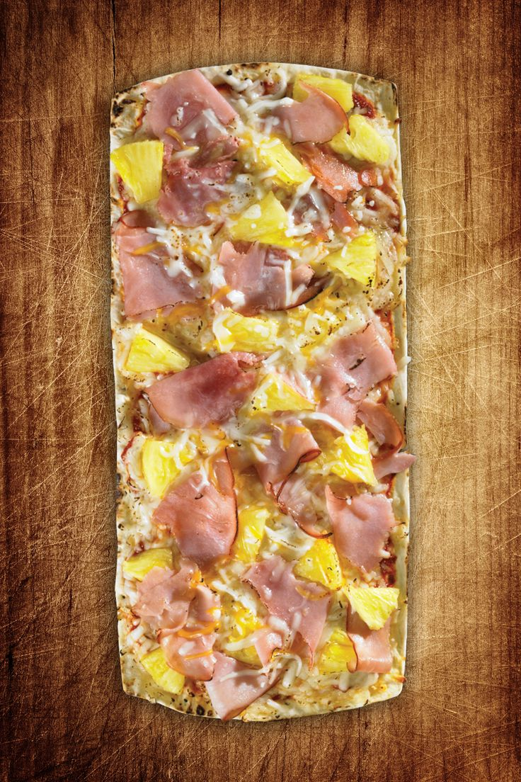 1 Flatout® Flatbread Artisan Thin Pizza Crust 3 slices Canadian bacon, cut into quarters 3 Tbsp. pineapple, diced 1/2 cup mozzarella cheese, shredded 1 tbsp. Parmesan cheese, grated Place flatbread on a cookie sheet. Bake at 375 degrees for two minutes. Remove from oven. Spread the shredded mozzarella on the flatbread. Top with pineapple, bacon Continue Reading...
