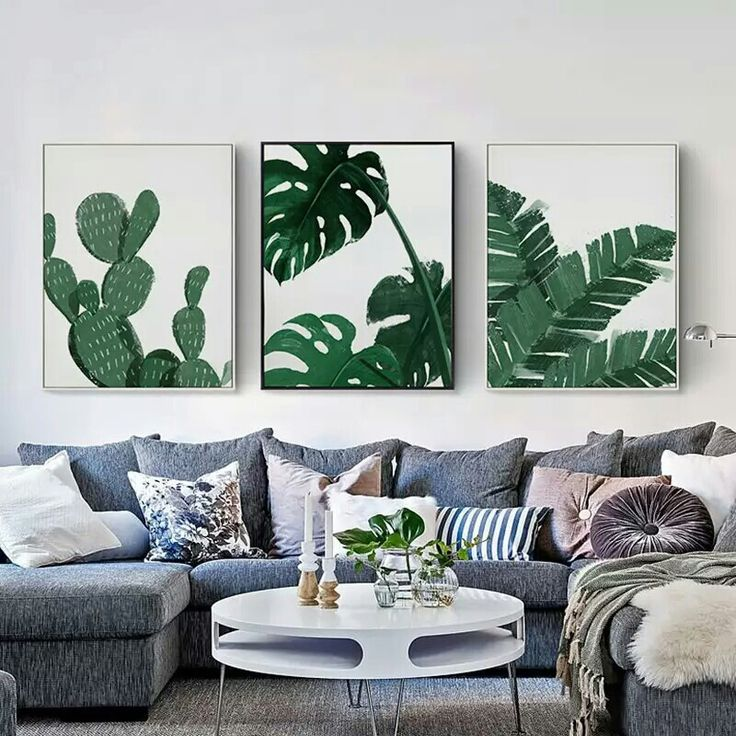 The idea of the 3 large portraits over couch.
