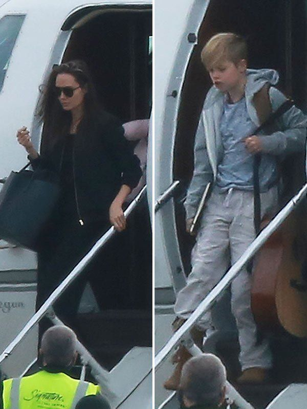 angelina-jolie-a-guitar-carrying-shiloh-fly-out-of-colorado-after-family-vacation-ftr