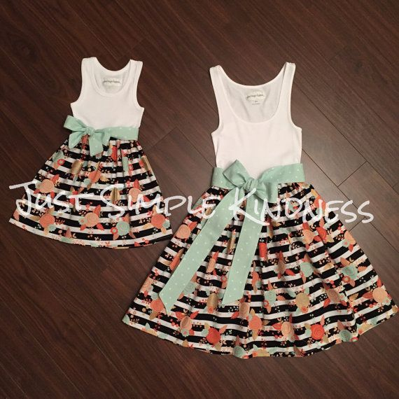 This Listing is for a Mommy & Me dress set. Dresses are Tank Style and both includes a fabric belted Sash. Tank styles will vary on