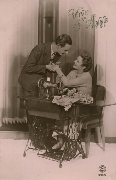 Vintage sewing postcard - couple posing with Singer sewing machine (postmarked 1936).