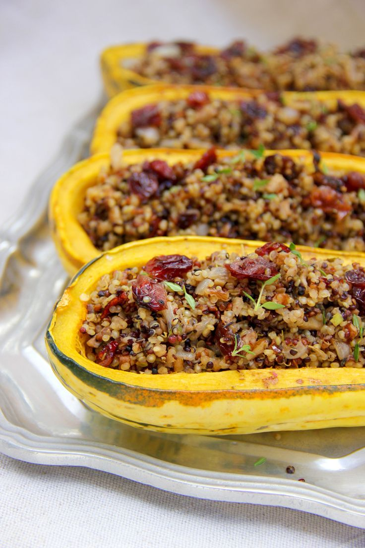 This Quinoa and Cranberry Stuffed Delicata Squash recipe is the perfect main dish for a Thanksgiving dinner or any of the upcoming holidays.