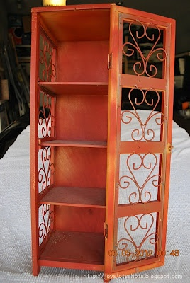 I love the idea of painting a thrift store cabinet orange. Via Sugar Bee crafts