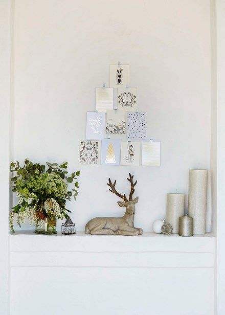 Create a festive vignette with a tree-shaped stack of pretty Christmas cards.  Home Beautiful Magazine Australia