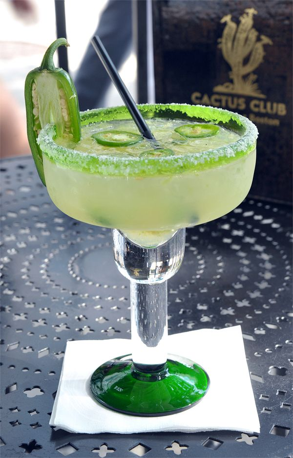 Jalapeno Margarita Cocktail. The jalepeño compliments the sweetness of both the fruit juices and sour mix, with a little kick of heat, makes for a refreshing summer cocktail.