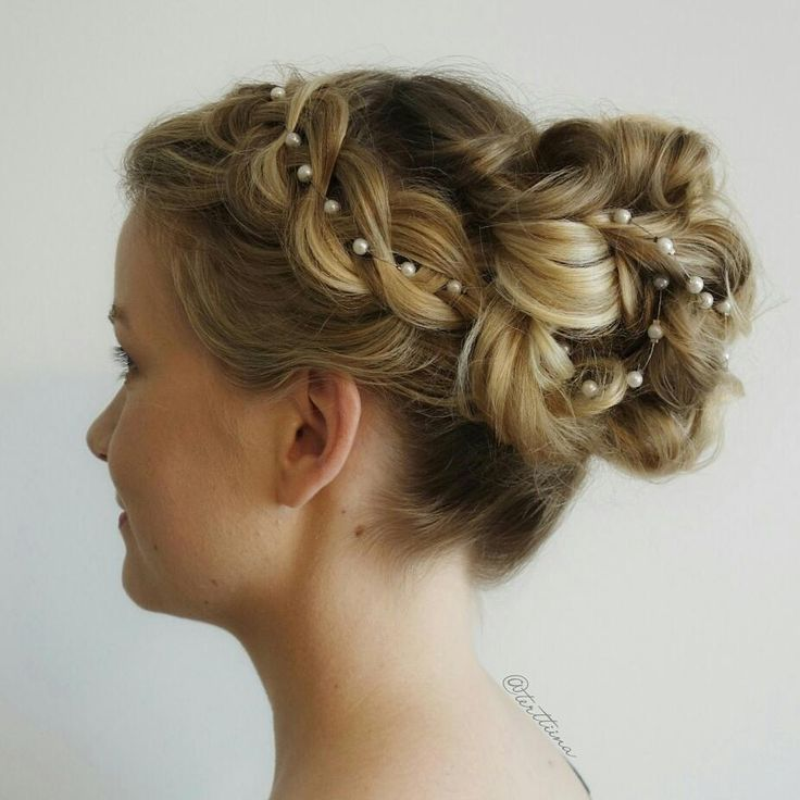 Hair  by Terhi A (@terttiina) Instagram: hair of the beautiful bride. Four strand ribbon braid with handmade pearl string into a curly bun! #weddinhairstyle