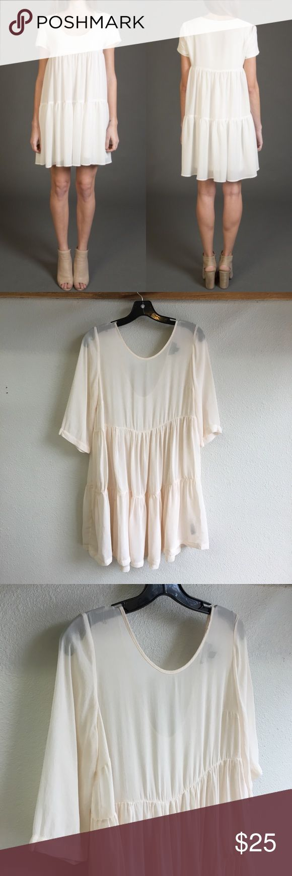 TopShop tiered boho sheer pastel dress Markings as shown in picture, located at the bottom right corner and left. Not noticeable because of the ruffle. Size 4. Sheer. 33inches long. Blush color Topshop Dresses