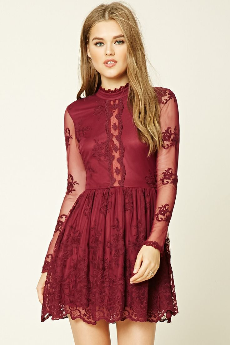 A mesh knit skater dress featuring an allover floral pattern, lace trim details, a sheer floral lace detail along the front, a scalloped mock neck with a back button closure, sheer long sleeves with scalloped cuffs, an invisible side zipper, back scalloped cutout, and a scalloped hem.