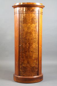 "A late 19th Century French burr walnut pier cabinet of oval drum form having stepped and moulded cornice above a single door  enclosing 3 shelves, raised on plinth base 55""h x 24""w x 15""d SOLD FOR £800"