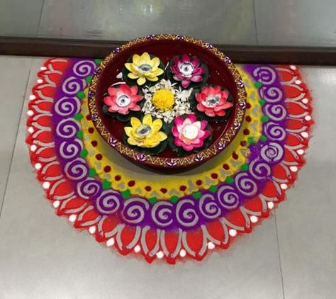 Make simple Diwali rangoli designs and welcome goddess Lakshmi into your home. Use flowers, flower petals and rangoli powder to create beautiful rangolis.
