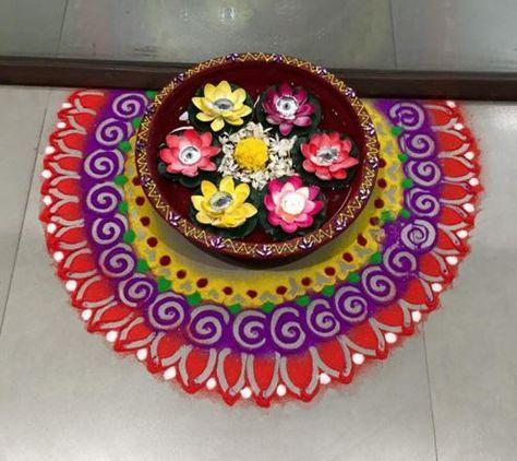 Make simple Diwali rangoli designs and welcome goddess Lakshmi into your home. Use flowers, flower petals and rangoli powder to create beautiful rangolis.