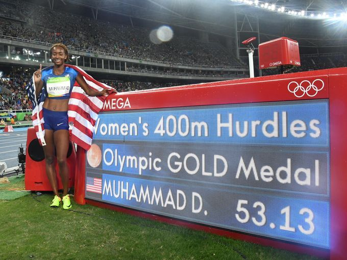 Dalilah Muhammad (USA) celebrates after winning the