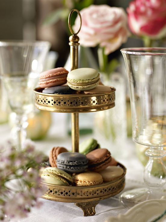 Macarons in brass cake stand - perfect for afternoon tea