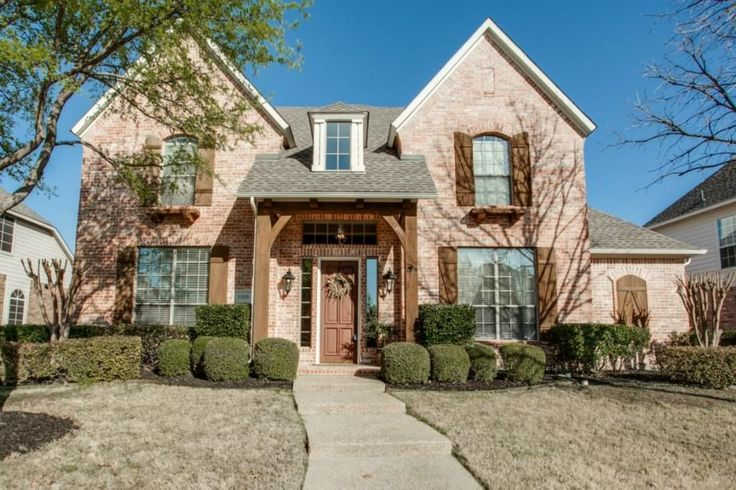 Loving This Two Story Red Brick Home With Wood Shutters