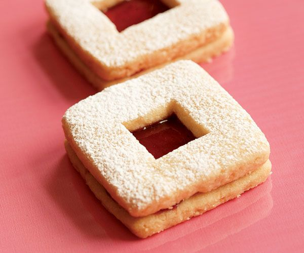 Rich, buttery shortbread cookies with a peek-a-boo window of jam or ...
