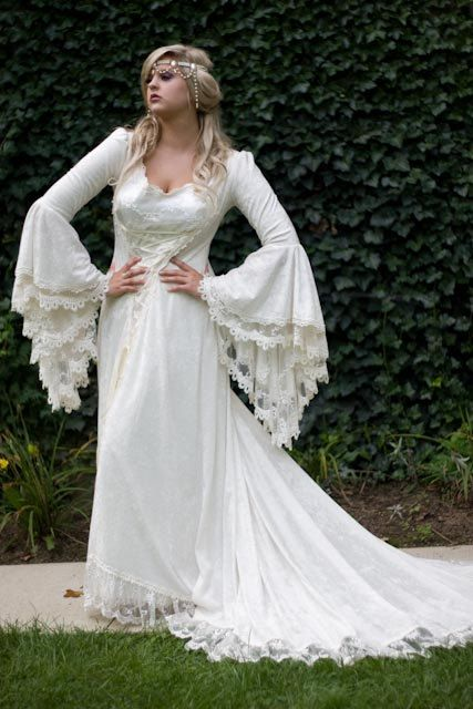 Has a Sir Lancelot feel...A little bit gypsy a little Royal Court. Another lovely Etsy Seller find. Victoria Velvet and Lace Medieval Wedding Gown by RomanticThreads, $895.00
