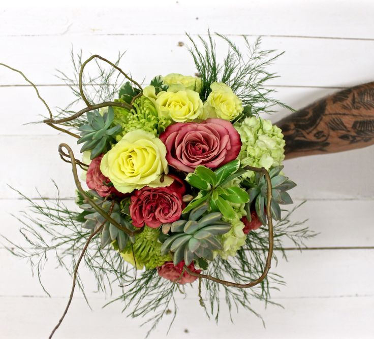 Wedding bouquet with flowers and succulent.
