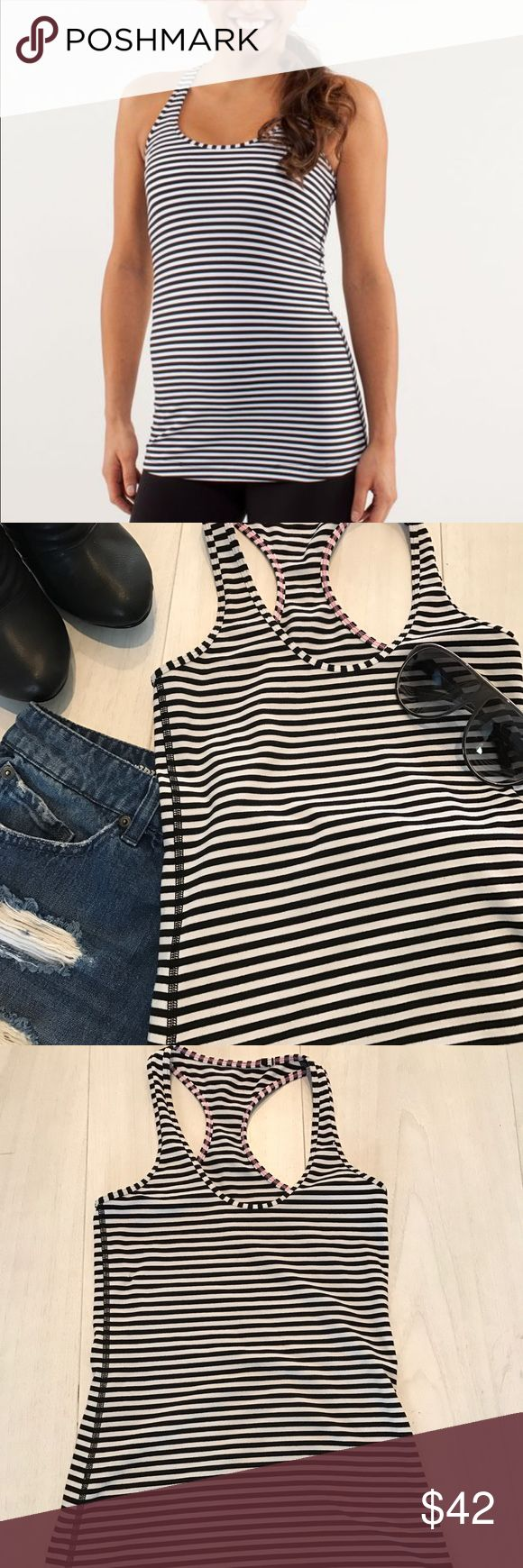 🆕Lululemon Cool Razorback Tank Gently worn, Lululemon cool razorback tank. Size tag removed but fits like a 4. White and black striped with pink stitching. Please use the offer button and bundle for a discount. Thanks 💋 lululemon athletica Tops Tank Tops