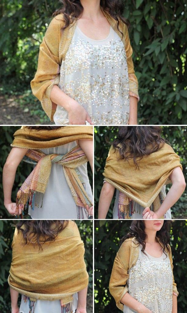 A slightly more advanced version of the wrap. Put the scarf around your shoulders like a shawl and make a half knot in the back with the ends. Pull the ends tight and up high on your back. Pull the scarf fabric down to cover the ends.