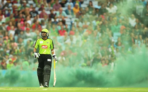 Tillakaratne Dilshan of the Thunder walks onto the field at the start of the Big Bash League match between Sydney Thunder and the Sydney Sixers at ANZ Stadium on January 25, 2014 in Sydney, Australia. (January 24, 2014 - Source: Mark Metcalfe/Getty Images AsiaPac)