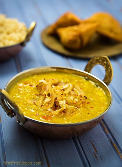 Easy Fat-Free Dal Tadka (1/2 cup split red lentils (masoor dal), 1/2 cup yellow moong dal (split mung beans) OR yellow split peas OR additional red lentils, 3 c water, 1 large tomato, 3 cloves garlic, 1 t ginger root, 1 t cumin seeds, 1/2 t turmeric, 1/2 t salt, 1/2 t garam masala + more to taste, 1 large onion, (1/2 sliced and 1/2 chopped), and 1/2 t red pepper flakes)