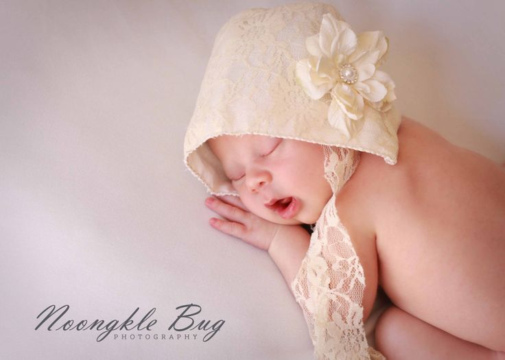 Sound asleep in a precious bonnet by whimsical love design props cape town newborn photography