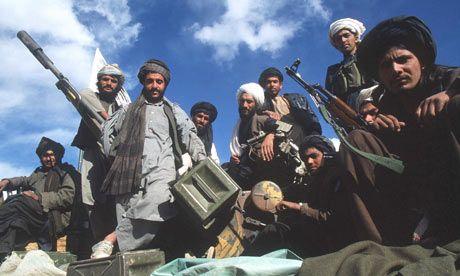 sufis with sub-machine guns